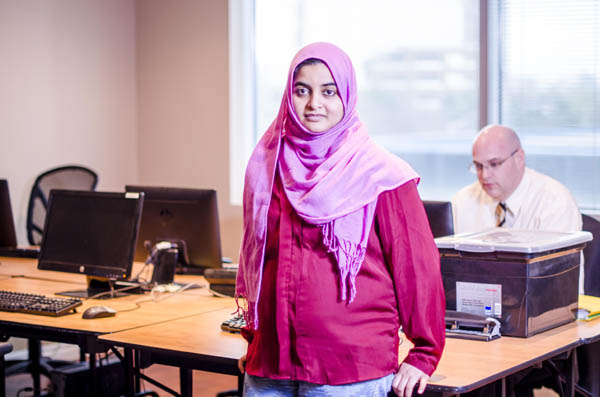 Toronto-Female student standing in the computer lab
